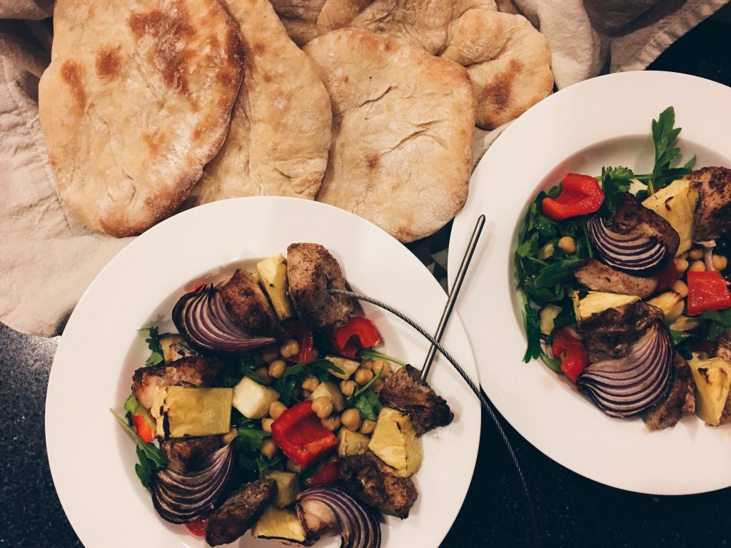 Allspice chicken skewers with eggplant salad